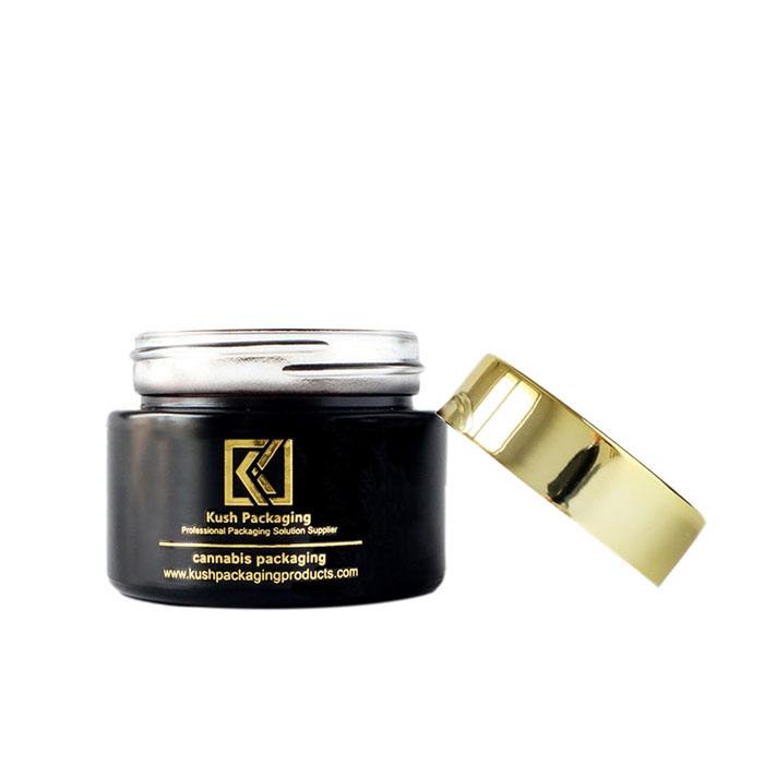 1oz child proof matte black glass jar with gold lid